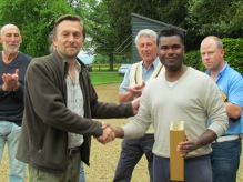 Dom Ramjag picks up his Man of the match whisky for his match winning 75*