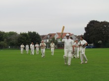 John acknowledges the applause for his match-winning 89*