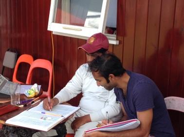 Gabriel and Rohan write up the scorebooks