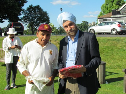 Neeraj presents KCC club wear to Navtej Sarna, the Indian High Commissioner