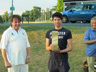 Man of the Match Shafiq Hussain holds up the Johnnie Walker