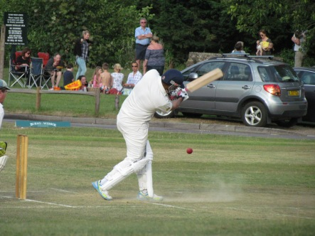Sid blasts one to the boundary on his way to a fifty