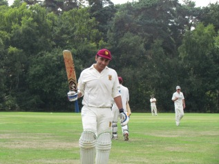 Shahzeb raises his bat