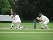 Regan cover drives along the ground (for a change)