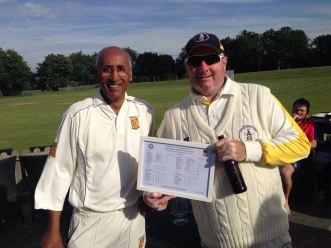 San presents John Reeve with a framed scorecard of last year's tie