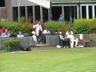 The debacle is viewed from the pavilion as we lose the last 6 wickets for 18 runs