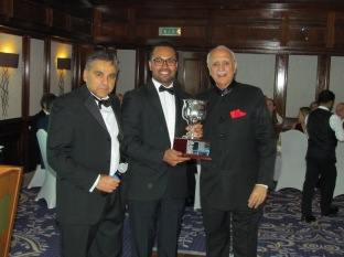 Saikat flanked by Neeraj and Sunil wins the Cricketer of the Year Cup with Sid (not present)