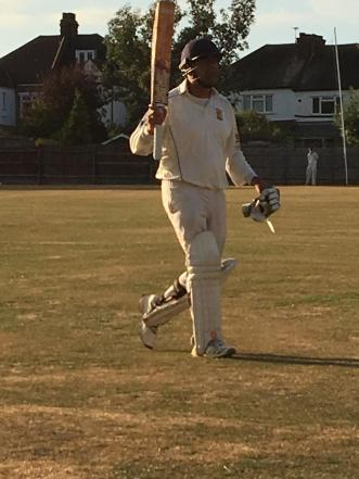 Preetinder raises his bat after getting out for 96