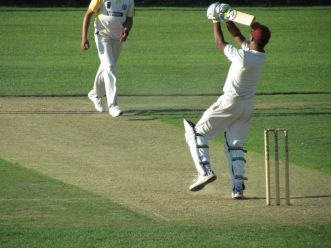 Saikat smashes a six over the bowler's head