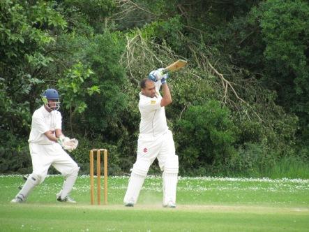 Sid Chhibbar forces a drive