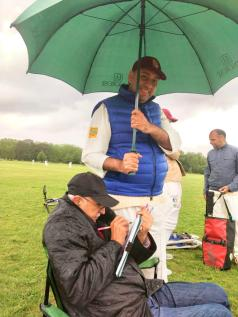 Sunil scoring in the rain - cover provided by Chetan