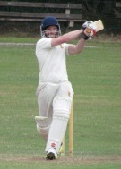 Tim strikes the first of his sixes in the last over, needing 25 to win