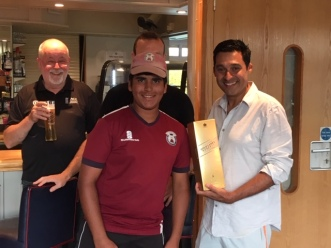Wimbledon Man of the Match, Pranav Khera, collects the Johnnie Walker