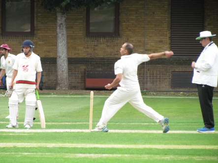 Sid delivers from behind the stumps to bowl Matt Edwards