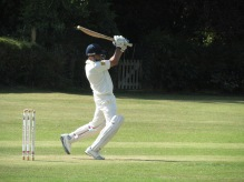 Nitin executes a back foot drive with power