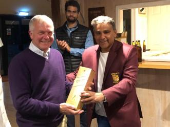 Tim Drake accepts the Man of the Match Whisky for his tight bowling and match-winning innings