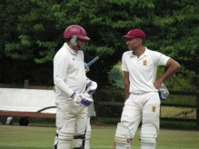 Neeraj and Rohan chat during their 59 run partnership for the 8th wicket