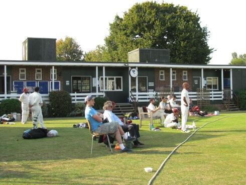 Spectators enjoying the sunshine and cricket